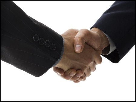 introductions: Two Businessmen Shaking Hands