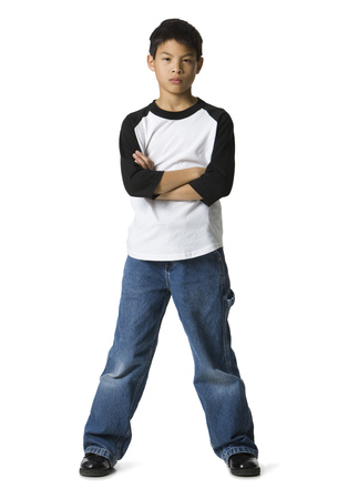 Portrait Of A Boy Standing With His Arms Crossed