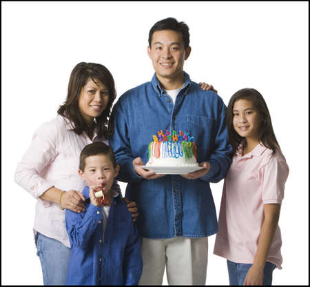 kids birthday party: Portrait Of A Family With A Birthday Cake