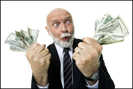 closed fist: Close-Up Of A Businessman Holding Money In His Fists