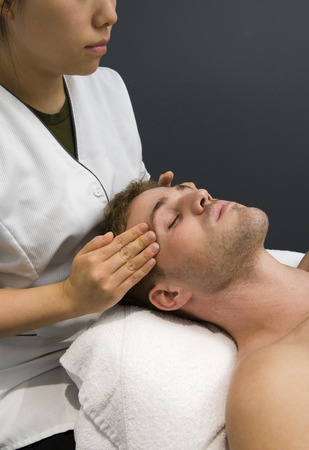 caregivers: Close-Up Of An Adult Man Receiving A Head Massage