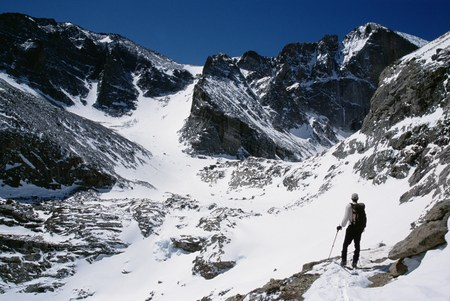 Rear View Of A Hiker Looking At A Mountain Peak LANG_EVOIMAGES