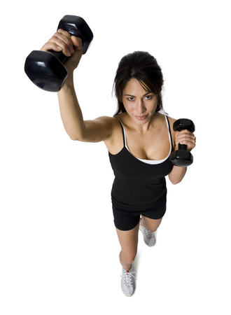 Portrait Of A Woman Exercising With Dumbbells LANG_EVOIMAGES