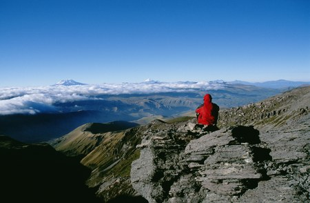 Rear View Of A Person Sitting On A Mountain LANG_EVOIMAGES