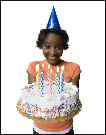 Portrait Of A Young Woman Holding A Birthday Cake LANG_EVOIMAGES