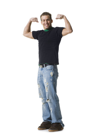 Portrait Of A Young Man Flexing Muscles