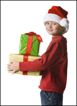 give out: Portrait Of A Boy Holding Christmas Presents