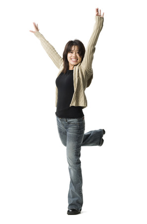 vietnamese ethnicity: Portrait Of A Woman Dancing On One Leg With Her Arms Raised