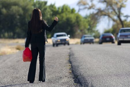 Woman Hitchhiking While Holding A Gas Can