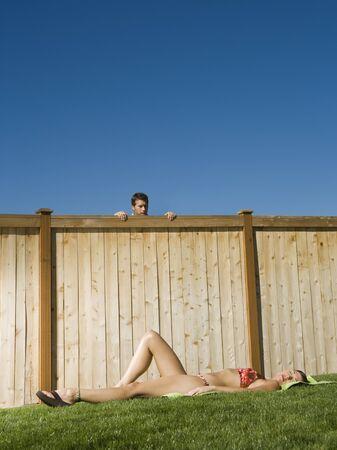 flip flops: Man Watching A Woman Sunbathe