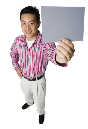 Portrait Of A Mid Adult Man Holding A Blank Sign LANG_EVOIMAGES