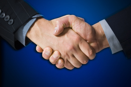 introductions: Close-Up Of Two Businessmen Shaking Hands