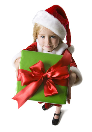 Portrait Of A Girl Holding A Christmas Present