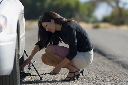 Profile Of A Woman Fixing A Flat Tire