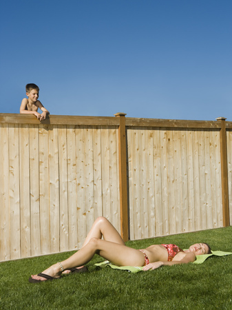 flip flops: Boy Watching A Woman Sunbathe