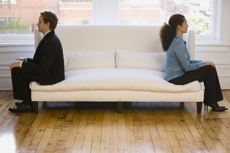 substructure: Businessman And A Businesswoman Sitting Back To Back On A Couch LANG_EVOIMAGES