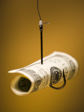 Close-Up Of An One Hundred Dollar Bill Hooked On A Fishing Hook