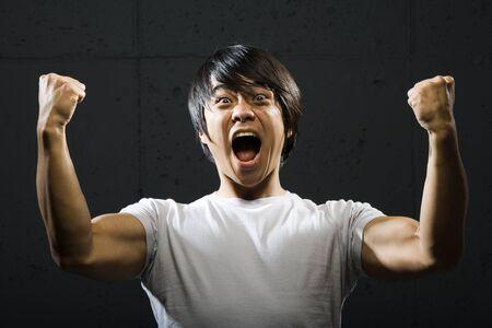 closed fist: Portrait Of A Mid Adult Man Flexing Biceps