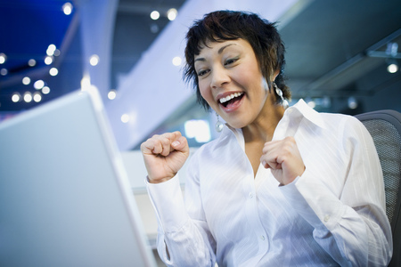 vietnamese ethnicity: Low Angle View Of A Businesswoman Laughing In Front Of A Laptop