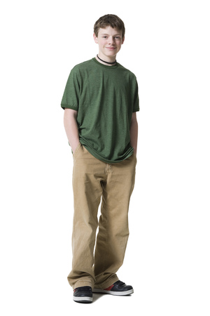 Portrait Of A Teenage Boy Standing With His Hands In His Pockets