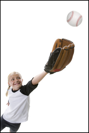 mitt: Low Angle View Of A Girl Catching A Baseball
