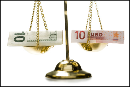 Close-Up Of Euro Banknotes On A Weighing Scale LANG_EVOIMAGES