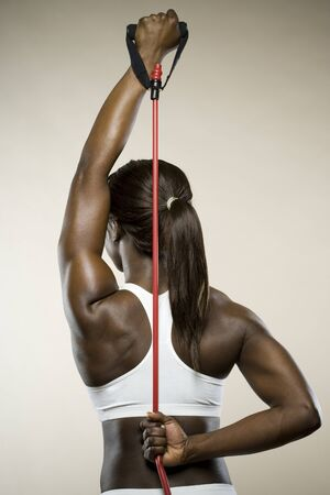 Rear View Of A Young Woman Exercising With A Jump Rope