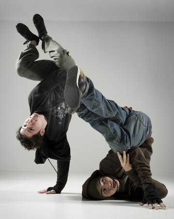 Two Young Men Break Dancing LANG_EVOIMAGES