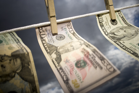Close-Up Of American Currency Pegged To A Clothesline