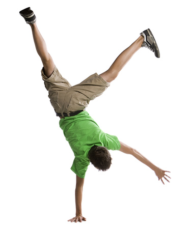 Rear View Of A Boy Doing A Handstand