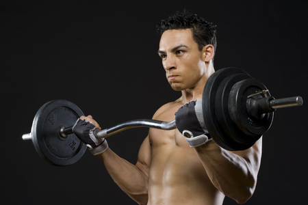 Close-Up Of A Mid Adult Man Lifting A Barbell