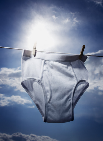 Close-Up Of A Mens Underwear Hanging On A Clothesline LANG_EVOIMAGES
