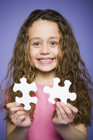 Portrait Of A Girl Holding A Puzzle Piece