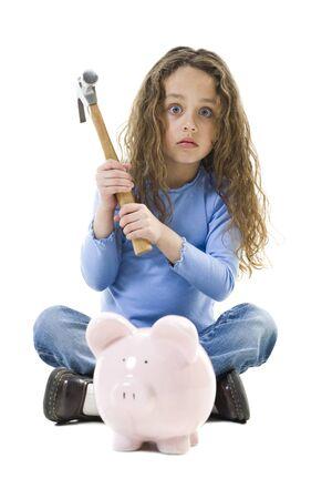 Portrait Of A Girl Holding A Hammer Over A Piggy Bank