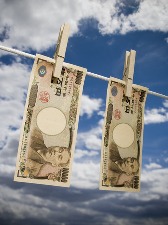 Low Angle View Of Japanese Paper Currency Pegged On A Clothesline LANG_EVOIMAGES