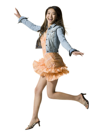 Portrait Of A Young Woman Jumping LANG_EVOIMAGES