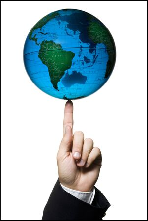 Man Balancing A Globe On His Finger