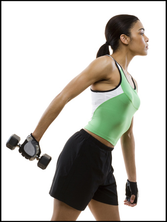 Profile Of A Young Woman Exercising With A Dumbbell LANG_EVOIMAGES