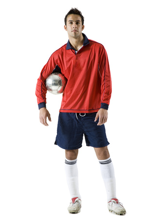 Portrait Of A Young Man Holding A Soccer Ball
