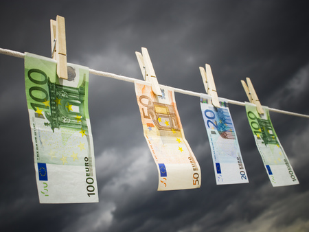 Close-Up Of Euro Banknotes Pegged To A Clothesline LANG_EVOIMAGES