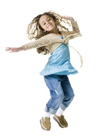 Portrait Of A Girl Jumping In Mid Air