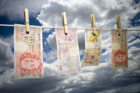 Low Angle View Of English Paper Currency Pegged On A Clothesline