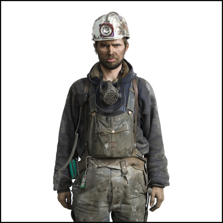 clutter: Portrait Of A Miner Wearing A Hardhat With A Headlamp