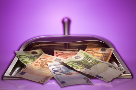 Close-Up Of Euro Notes In A Dustpan