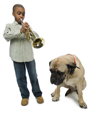 Boy Blowing A Trumpet Near A Dog LANG_EVOIMAGES