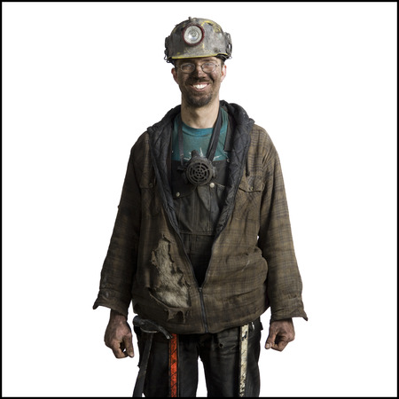 clutter: Close-Up Of A Miner Wearing A Hardhat With A Headlamp LANG_EVOIMAGES