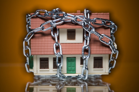 Close-Up Of A House Bound With A Chain LANG_EVOIMAGES