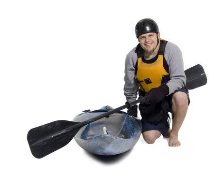 lifevest: Portrait Of A Young Man Kneeling Beside A Kayak LANG_EVOIMAGES
