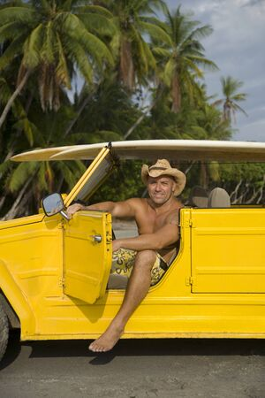Portrait Of A Man Sitting In A Yellow Car