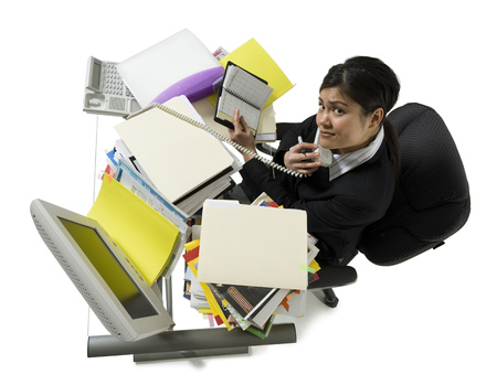 High Angle View Of A Businesswoman Multi-Tasking In An Office